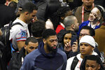 Anthony Davis, foreground, of the Los Angeles Lakers walks through the media during the NBA All-Star basketball game media day, Saturday, Feb. 15, 2020, in Chicago. (AP Photo/David Banks)