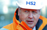 """Britain's Prime Minister Boris Johnson looks on during a visit to Curzon Street railway station where the new High Speed 2 (HS2) rail project is under construction, in Birmingham, England, Tuesday Feb. 11, 2020.  Boris Johnson said his Cabinet had given the """"green light"""" to the high-speed rail line that will link London with central and northern England, despite the huge cost prediction and opposition from environmentalists. (Eddie Keogh/Pool via AP)"""