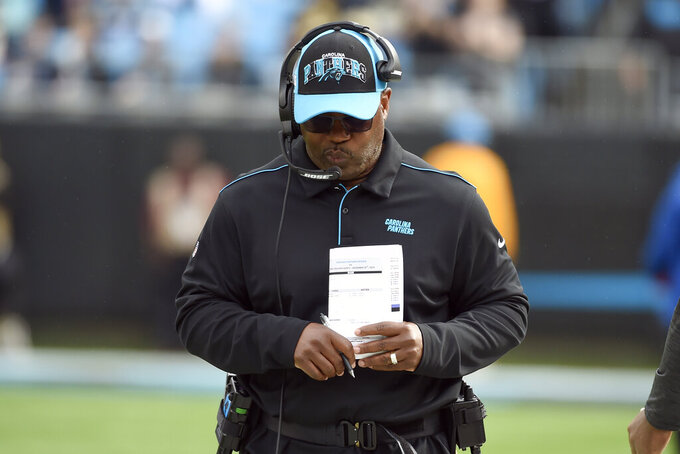 Carolina Panthers head coach Perry Fewell walks the sidelines during the first half of an NFL football game against the New Orleans Saints in Charlotte, N.C., Sunday, Dec. 29, 2019. (AP Photo/Mike McCarn)