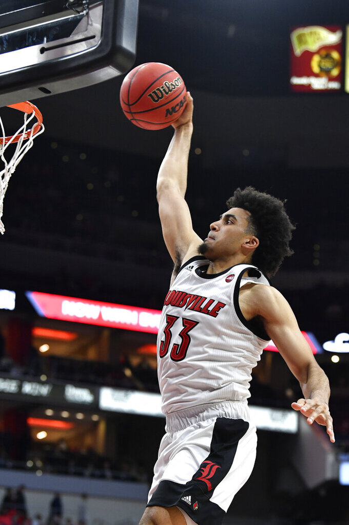Louisville forward Jordan Nwora goes in for a dunk during the second half of the team's NCAA college basketball game against Miami (Ohio) in Louisville, Ky., Wednesday, Dec. 18, 2019. Louisville won 70-46. (AP Photo/Timothy D. Easley)