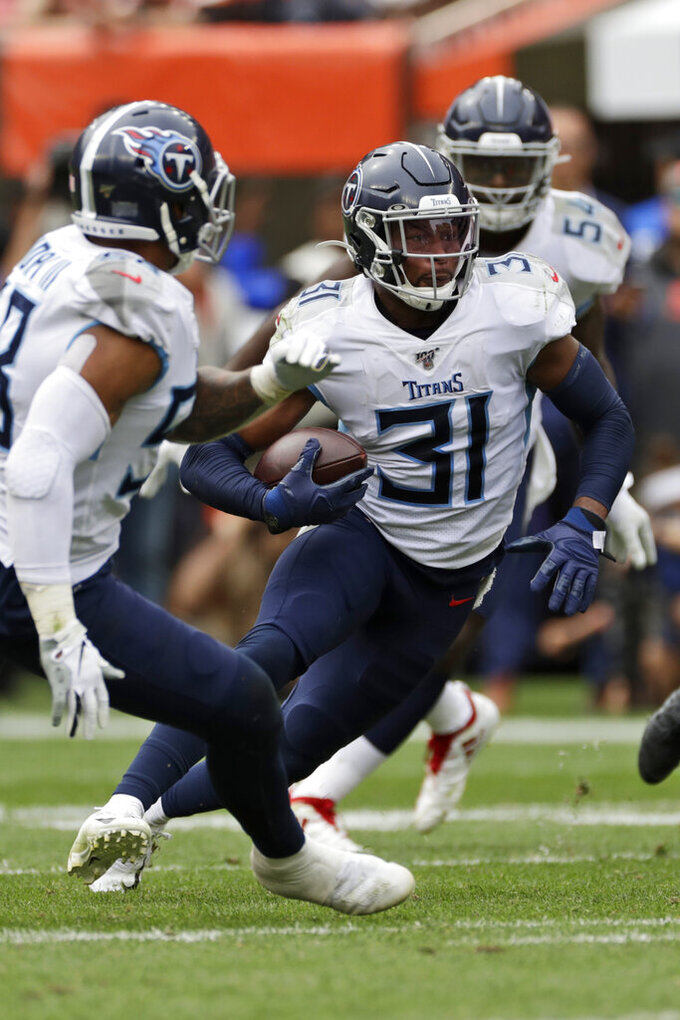 Tennessee Titans free safety Kevin Byard (31) rushes after intercepting the ball during the second half in an NFL football game against the Cleveland Browns, Sunday, Sept. 8, 2019, in Cleveland. (AP Photo/Ron Schwane)
