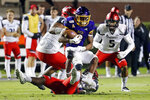 East Carolina's Demetrius Mauney (3) is tackled by Cincinnati's Perry Young (6), Curtis Brooks (92) and Darrick Forrest (5) during the second half of an NCAA college football game in Greenville, N.C., Saturday, Nov. 2, 2019. (AP Photo/Karl B DeBlaker)