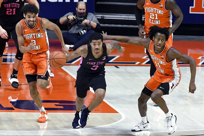 Penn State guard Sam Sessoms (3) steals the ball and is pursued by Illinois guard Jacob Grandison (3) and guard Ayo Dosunmu (11) during the first half of an NCAA college basketball game Tuesday, Jan. 19, 2021, in Champaign, Ill. (AP Photo/Holly Hart)