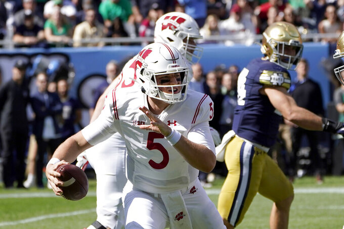 Wisconsin quarterback Graham Mertz scrambles during the first half of an NCAA college football game against Notre Dame Saturday, Sept. 25, 2021, in Chicago. (AP Photo/Charles Rex Arbogast)