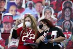Tampa Bay Buccaneers fans take photos before the NFL Super Bowl 55 football game between the Kansas City Chiefs and Tampa Bay Buccaneers, Sunday, Feb. 7, 2021, in Tampa, Fla. (AP Photo/Ashley Landis)