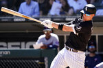 Chicago White Sox's Zack Collins hits a solo home run during the sixth inning of a baseball game against the Minnesota Twins in Chicago, Thursday, July 1, 2021. (AP Photo/Nam Y. Huh)