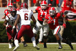 Georgia running back D'Andre Swift (7) moves the ball in the first half of a NCAA football game between Georgia and South Carolina in Athens, Ga., on Saturday, Oct. 12, 2019. (Joshua L. Jones/Athens Banner-Herald via AP)