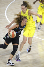 New York Liberty forward Sabrina Ionescu (20) drives past Seattle Storm forward Breanna Stewart (30) during the first half of a WNBA basketball game, Saturday, July 25, 2020, in Ellenton, Fla. (AP Photo/Phelan M. Ebenhack)