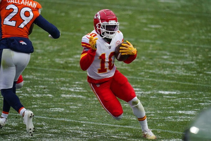 Kansas City Chiefs wide receiver Tyreek Hill runs with the ball during the second half of an NFL football game against the Denver Broncos, Sunday, Oct. 25, 2020, in Denver. (AP Photo/Jack Dempsey)