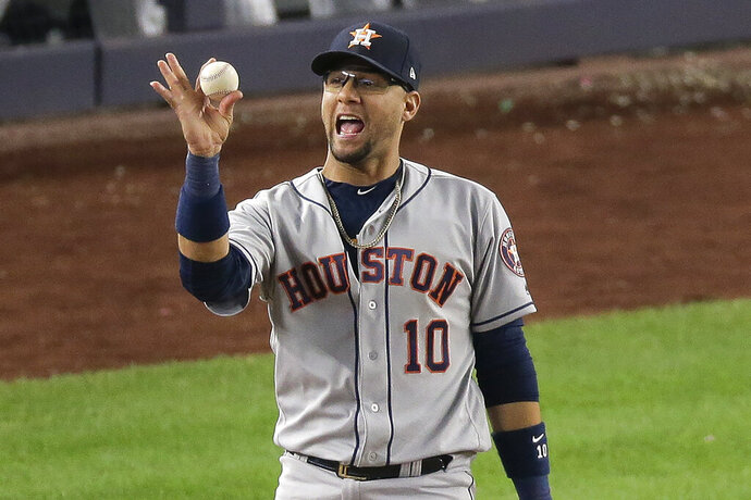 Houston Astros first baseman Yuli Gurriel (10) reacts after making the play at first for the third out to end Game 3 of baseball's American League Championship Series against the New York Yankees, Tuesday, Oct. 15, 2019, in New York. The Astros won 4-1.(AP Photo/Seth Wenig)