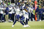 Seattle Seahawks' Shaquill Griffin and Shaquem Griffin celebrate a sack during the second half of an NFL divisional playoff football game against the Green Bay Packers Sunday, Jan. 12, 2020, in Green Bay, Wis. (AP Photo/Mike Roemer)