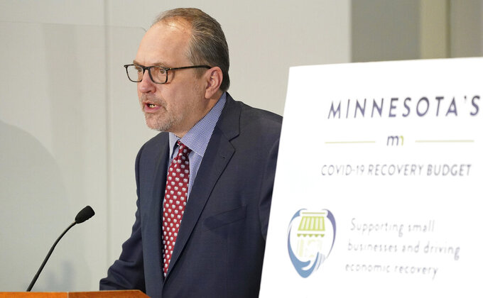Minnesota Management and Budget Commissioner Jim Schowalter speaks during a news conference to debut the state budget plan for the next two years Tuesday, Jan. 26, 2021 at the Department of Revenue building in St. Paul, Minn. (Anthony Souffle/Star Tribune via AP)