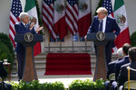 President Donald Trump listens as Mexican President Andres Manuel Lopez Obrador claps during an event in the Rose Garden at the White House, Wednesday, July 8, 2020, in Washington. (AP Photo/Evan Vucci)