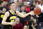 FILE-  In this March 22, 2019, file photo, Iowa's Joe Wieskamp passes the ball against Cincinnati in the second half during a first-round men's college basketball game in the NCAA Tournament in Columbus, Ohio, Friday,. Returning starters Joe Wieskamp and Luka Garza headline a roster that is deep at every position. (AP Photo/Tony Dejak, File)
