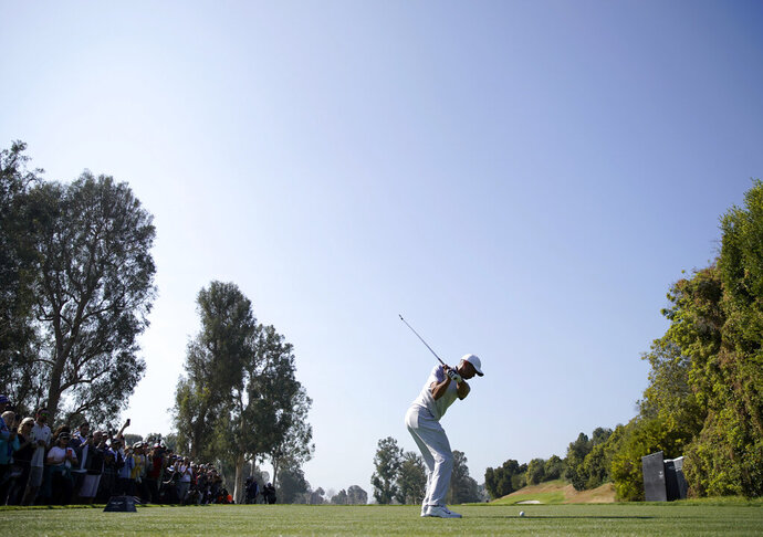 Tiger Woods tees off on the fourth hole during the second round of the Genesis Invitational golf tournament at Riviera Country Club, Friday, Feb. 14, 2020, in the Pacific Palisades area of Los Angeles. (AP Photo/Ryan Kang)