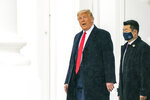 President Donald Trump walks on the North Portico as he leaves the White House, Sunday, Oct. 25, 2020, in Washington for a campaign rally in New Hampshire. (AP Photo/Manuel Balce Ceneta)