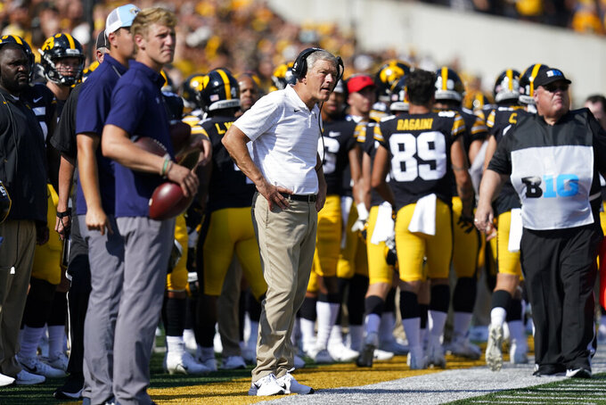 Iowa head coach Kirk Ferentz watches from the bench during the first half of an NCAA college football game against Kent State, Saturday, Sept. 18, 2021, in Iowa City, Iowa. Iowa won 30-7. (AP Photo/Charlie Neibergall)