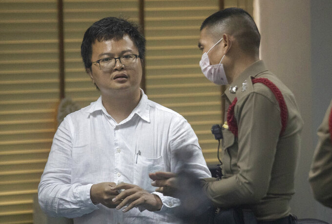 Pro-democracy activist and human rights lawyer Arnon Nampha talks to police at a police station, Friday, Aug, 7, 2020, in Bangkok, Thailand. The government cracked down on Friday with the arrests of some high profile members of the pro-democracy movement. Among them was  Arnon, who was arrested on charges of sedition and defying an emergency decree the government instituted months ago to try to control the spread of the coronavirus. (AP Photo/Sakchai Lalit)