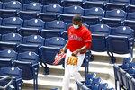 Philadelphia Phillies' Ramon Rosso walks through the stands during baseball practice at Citizens Bank Park, Tuesday, July 7, 2020, in Philadelphia. (AP Photo/Matt Slocum)