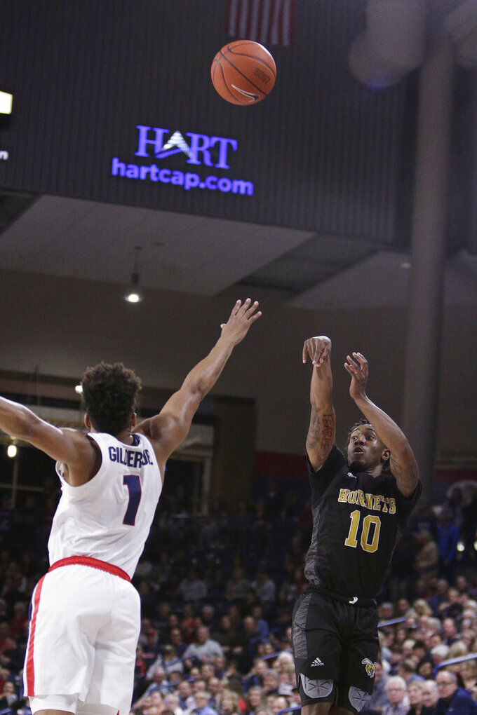 Alabama State guard Jacoby Ross (10) shoots over Gonzaga guard Admon Gilder (1) during the second half of an NCAA college basketball game in Spokane, Wash., Tuesday, Nov. 5, 2019. Gonzaga won 95-64. (AP Photo/Young Kwak)