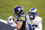 Seattle Seahawks tight end Jacob Hollister (86) catches a pass for a touchdown in front of Los Angeles Rams strong safety Jordan Fuller (32) during the second half of an NFL football game, Sunday, Dec. 27, 2020, in Seattle. (AP Photo/Elaine Thompson)
