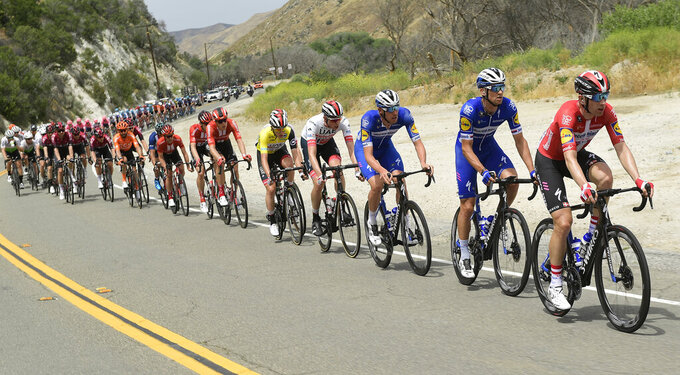 The peloton rides through the mountains during the seventh and final stage of the Tour of California bicycle race Saturday, May 18, 2019, near Santa Clarita, Calif. (AP Photo/Mark J. Terrill)