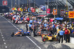 Scott Dixon, of New Zealand, pulls of pit lane during a practice session for the Indianapolis 500 auto race at Indianapolis Motor Speedway, Sunday, Aug. 16, 2020, in Indianapolis. (AP Photo/Darron Cummings)