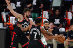 Boston Celtics' Jayson Tatum (0), right, drives around Toronto Raptors' Marc Gasol (33) and Kyle Lowry (7) during the first half of an NBA conference semifinal playoff basketball game Saturday, Sept. 5, 2020, in Lake Buena Vista, Fla. (AP Photo/Mark J. Terrill)