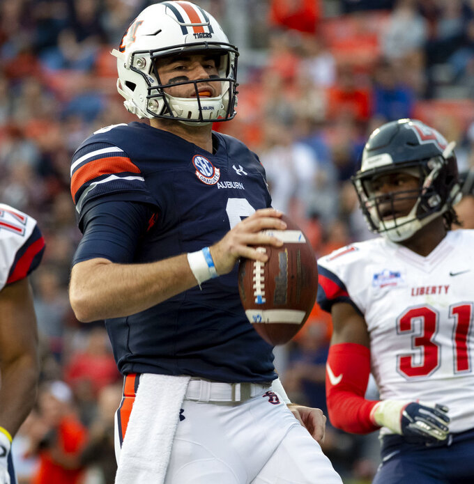 Auburn quarterback Jarrett Stidham (8) jogs in untouched for a running touchdown against Liberty during the first half of an NCAA college football game, Saturday, Nov. 17, 2018, in Auburn, Ala. (AP Photo/Vasha Hunt)
