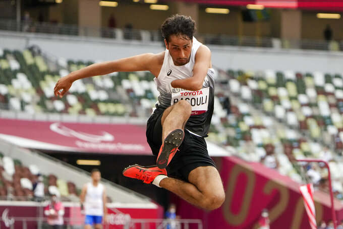 Afghanistan's Hossain Rasouli competes in the men's T47 long jump during the 2020 Paralympics at the National Stadium in Tokyo, Tuesday, Aug. 31, 2021. (AP Photo/Eugene Hoshiko)