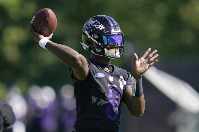 Baltimore Ravens quarterback Lamar Jackson works out during the team's NFL football training, Tuesday, June 15, 2021, in Owings Mills, Md. (AP Photo/Julio Cortez)
