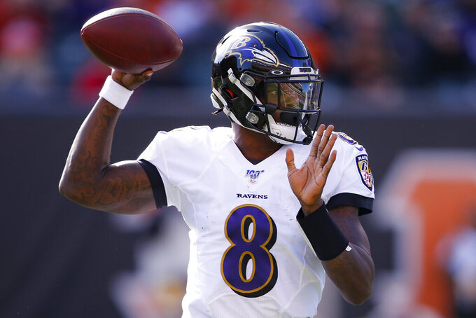 FILE - In this Nov. 10, 2019, file photo, Baltimore Ravens quarterback Lamar Jackson passes during the first half of NFL football game against the Cincinnati Bengals in Cincinnati. No one is missing Joe Flacco in Baltimore as Jackson has stamped himself as the best quarterback to come out of the 2018 draft. (AP Photo/Gary Landers, File)
