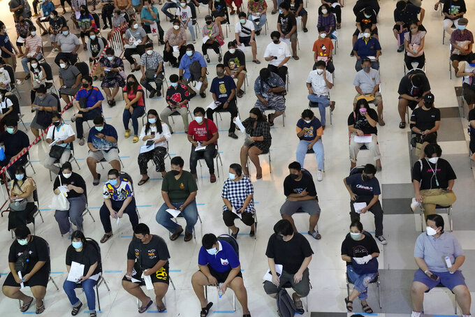 Residents wait for a dose of the Pfizer-BioNTech COVID-19 vaccine in Bangkok, Thailand, Wednesday, Aug. 25, 2021. Thailand has recorded more than 1 million accumulated cases on last week since the pandemic started in 2020. (AP Photo/Sakchai Lalit)