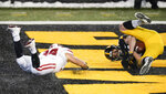 Iowa linebacker Jack Campbell intercepts a pass intended for Wisconsin fullback Mason Stokke, left, during the second half of an NCAA college football game, Saturday, Dec. 12, 2020, in Iowa City, Iowa. Iowa won 28-7. (AP Photo/Charlie Neibergall)