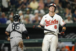 Baltimore Orioles' Ryan Mountcastle (6) reacts after striking out to end the seventh inning as New York Yankees catcher Kyle Higashioka (66) runs to the dugout during a baseball game, Tuesday, Sept. 14, 2021, in Baltimore. (AP Photo/Julio Cortez)