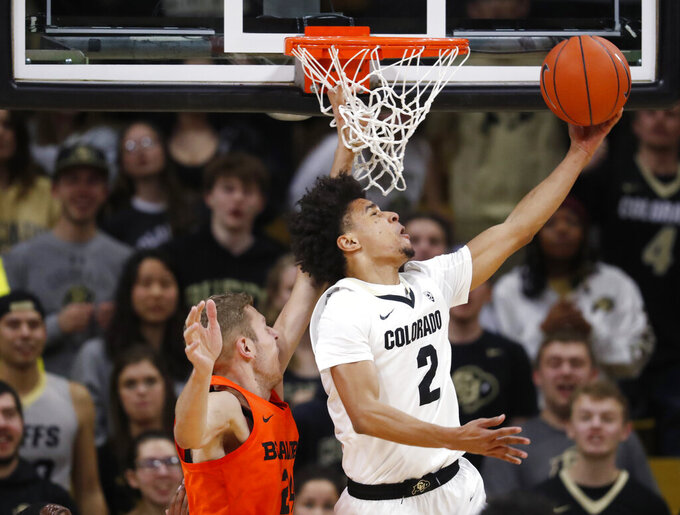 Colorado guard Daylen Kountz, right, drives to the rim for basket past Oregon State forward Kylor Kelley in the first half of an NCAA college basketball game Thursday, Jan. 31, 2019, in Boulder, Colo. (AP Photo/David Zalubowski)