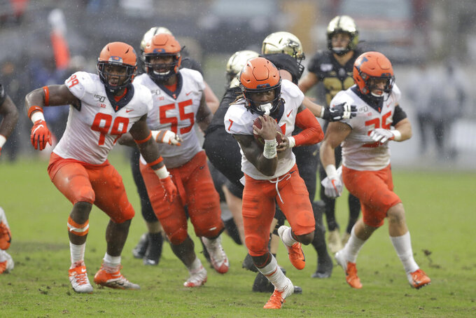 Illinois defensive back Stanley Green (7) runs back a fumble recovery during the second half of an NCAA college football game against Purdue, Saturday, Oct. 26, 2019, in West Lafayette, Ind. (AP Photo/Darron Cummings)