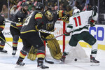 Vegas Golden Knights goalie Marc-Andre Fleury (29) makes a save against Minnesota Wild left wing Zach Parise (11) during the third period of Game 7 of an NHL hockey Stanley Cup first-round playoff series Friday, May 28, 2021, in Las Vegas. (AP Photo/Joe Buglewicz)