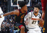 Denver Nuggets guard Jamal Murray, right, drives past Cleveland Cavaliers guard Collin Sexton during the first half of an NBA basketball game Saturday, Jan. 11, 2020, in Denver. (AP Photo/David Zalubowski)