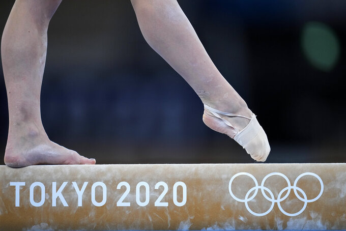 Liliia Akhaimova, of Russian Olympic Committee, performs on the balance beam during the women's artistic gymnastic qualifications at the 2020 Summer Olympics, Sunday, July 25, 2021, in Tokyo. (AP Photo/Natacha Pisarenko)