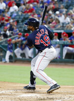 Boston Red Sox's Jackie Bradley Jr. follows through on a two-run double against the Texas Rangers in the first inning of a baseball game in Arlington, Texas, Tuesday, Sept. 24, 2019. The hit scored J.D. Martinez and Andrew Benintendi. (AP Photo/Tony Gutierrez)