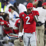 Georgia quarterback D'Wan Mathis reacts on the sideline after throwing an interception in the fourth quarter of the team's 44-28 loss to Florida in an NCAA college football game Saturday, Nov. 7, 2020, in Jacksonville, Fla. (Curtis Compton/Atlanta Journal-Constitution via AP)