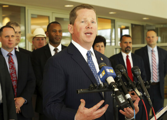 In this April 8, 2019, photo, United States Attorney Joseph Brown announces information regarding the fight against terrorism at the Collin County Courthouse in McKinney, Texas. Brown, a U.S. attorney in Texas who was appointed by President Donald Trump, announced his resignation Tuesday, May 26, 2020, providing no explanation for his unusually abrupt departure. (Jason Janik/The Dallas Morning News via AP)