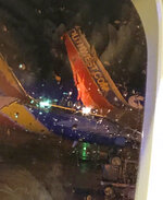 This photo taken onboard by a passenger on a Southwest Airlines flight to Atlanta appears to show the top fin of another Southwest Airlines plane clipped off after the two planes collided, Saturday, July 20, 2019, on the tarmac of Nashville International Airport, in Nashville, Tenn. The airline says both planes returned to the gate