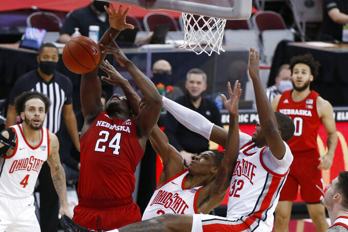 Nebraska's Yvan Ouedraogo, front left, is fouled by Ohio State's Eugene Brown, center, as E.J. Liddell defends during the first half of an NCAA college basketball game Wednesday, Dec. 30, 2020, in Columbus, Ohio. (AP Photo/Jay LaPrete)