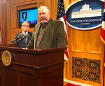 Terry Dawson, right, the son-in-law of a woman killed by a distracted driver in central Ohio on Christmas Eve 2017, describes how that accident has affected his family and made holidays much harder, at a news conference also attended by Ohio Gov. Mike DeWine, on Friday, Dec. 20, 2019, in Columbus, Ohio. DeWine said he wants distracted driving made a primary offense and promised a legislative proposal soon. (AP Photo/Andrew Welsh-Huggins)