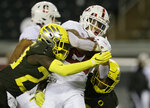 Stanford's Austin Jones, center, breaks for yardage against Oregon during the first quarter of an NCAA college football game Saturday, Nov. 7, 2020, in Eugene, Ore. (AP Photo/Chris Pietsch)
