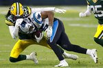 Green Bay Packers' Kevin King stops Carolina Panthers' Rodney Smith during the second half of an NFL football game Saturday, Dec. 19, 2020, in Green Bay, Wis. (AP Photo/Matt Ludtke)