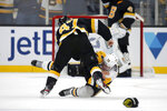 Boston Bruins defenseman Torey Krug (47) sends Pittsburgh Penguins right wing Patric Hornqvist (72) to the ice with a punch during a fight in the second period of an NHL hockey game, Thursday, Jan. 16, 2020, in Boston. (AP Photo/Mary Schwalm)