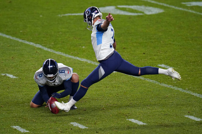 Tennessee Titans kicker Stephen Gostkowski approaches his field goal attempt as punter Brett Kern (6) holds during the second half of an NFL football game against the Denver Broncos, Monday, Sept. 14, 2020, in Denver. Gostkowski missed the attempt. (AP Photo/Jack Dempsey)